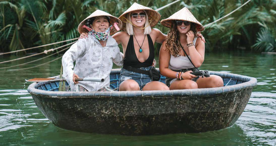 girls in basket boats in Hoi An