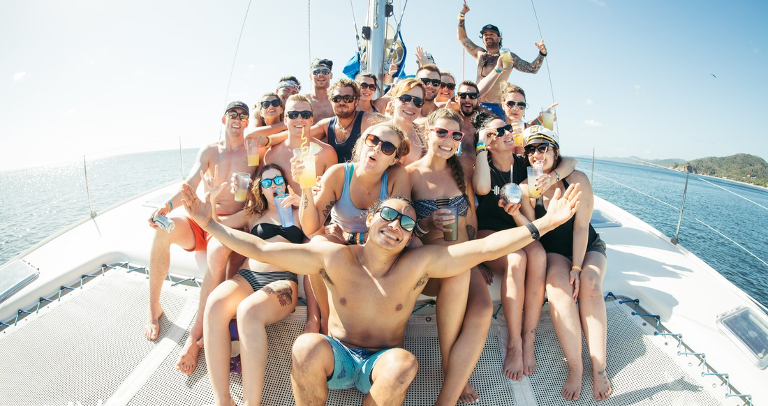 A group of people party on a catamaran