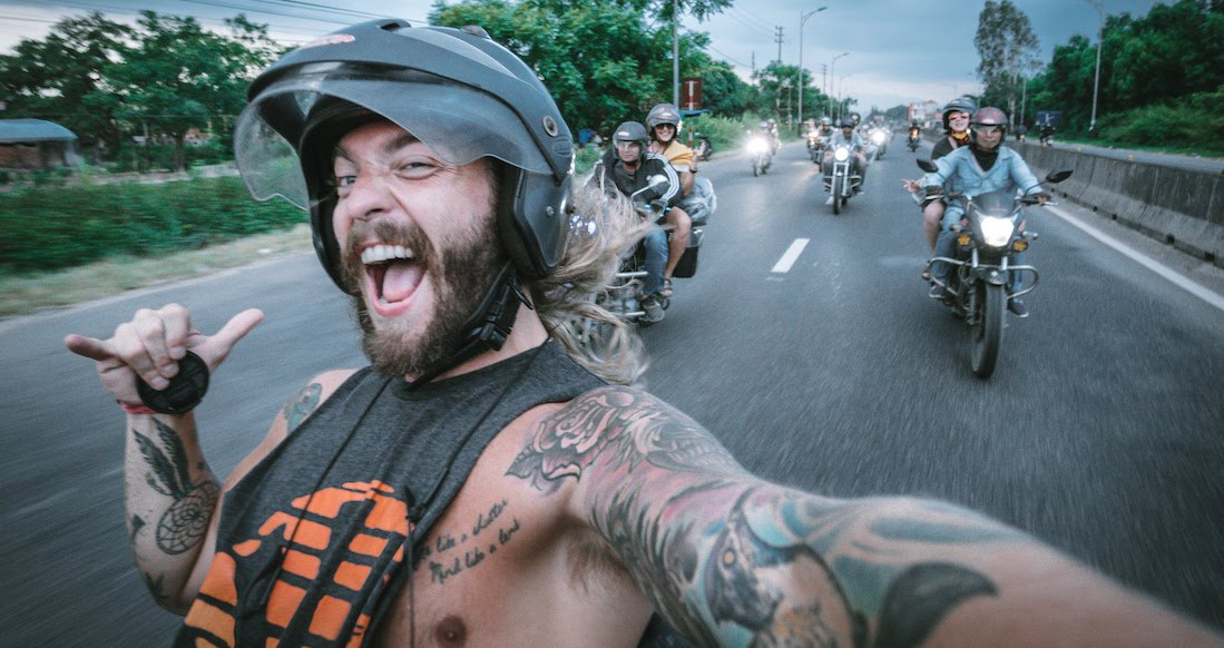 stoked traveler on a motorcycle tour