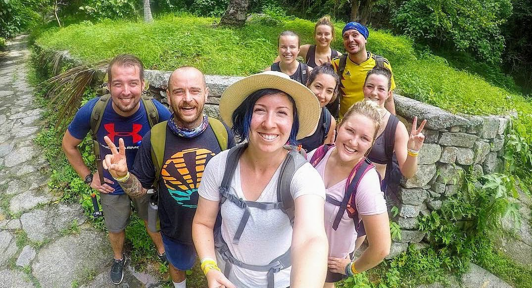 A group of travelers poses in the jungles of Colombia.