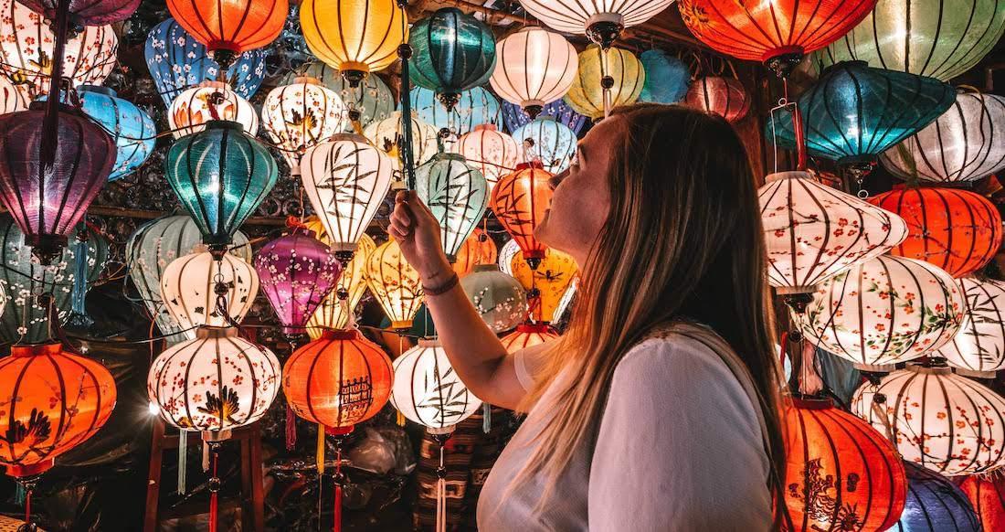 traveler looking at Vietnamese lanterns