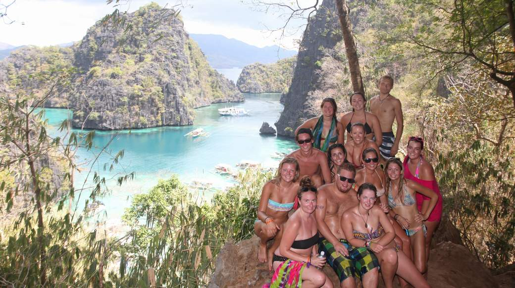 a group of travelers at a viewpoint in Palawan Philippines