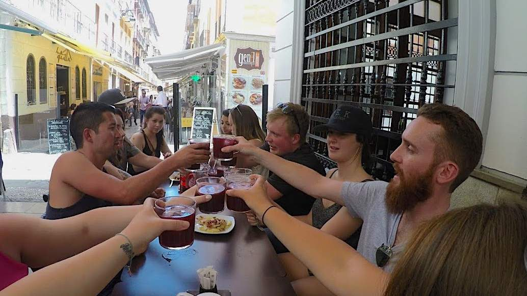 A group of people toasting cups of sangria