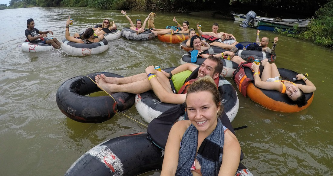 A group of travelers tubing down a river in Colombia