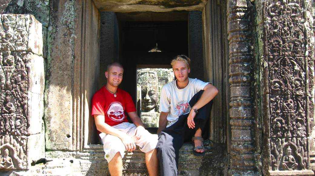 Two guys touring Angkor Wat temple
