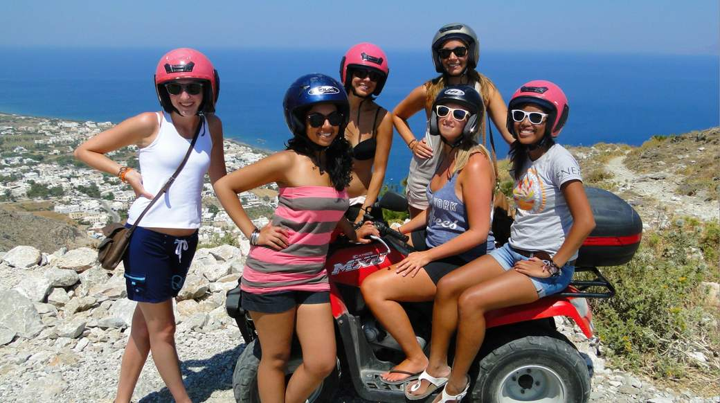 Girls riding ATV's in Greece with a nice viewpoint