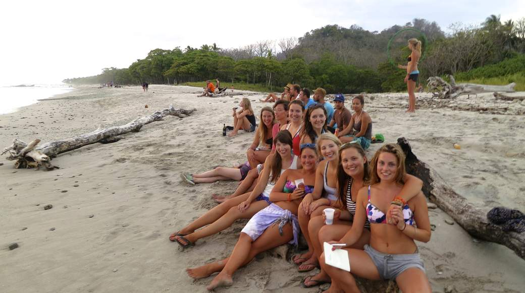 Group of girls on a beach in costa rica