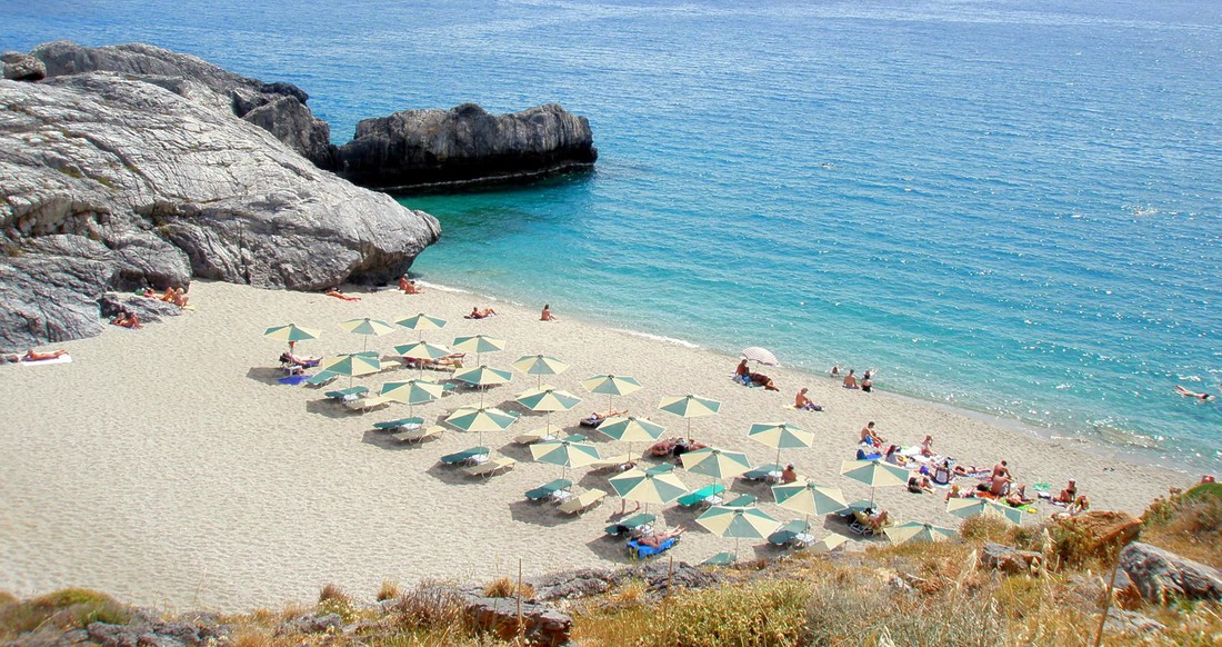 secluded beach with umbrellas in the Greek Islands