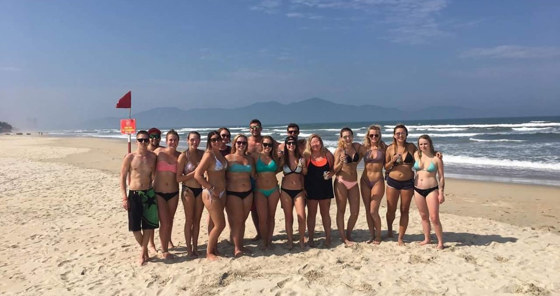 A group of happy travelers on a beach in Vietnam