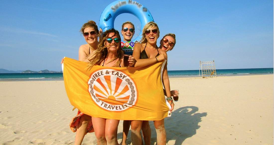 beautiful girls on a beach in Vietnam holding a flag