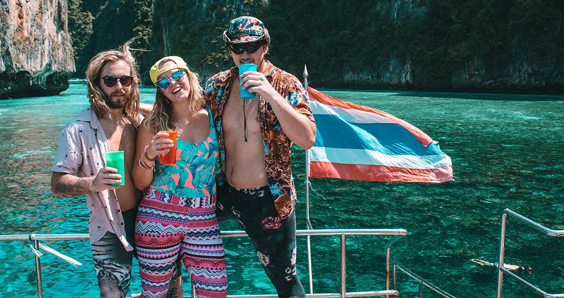 Three travelers on a party boat in Koh Phi Phi Thailand