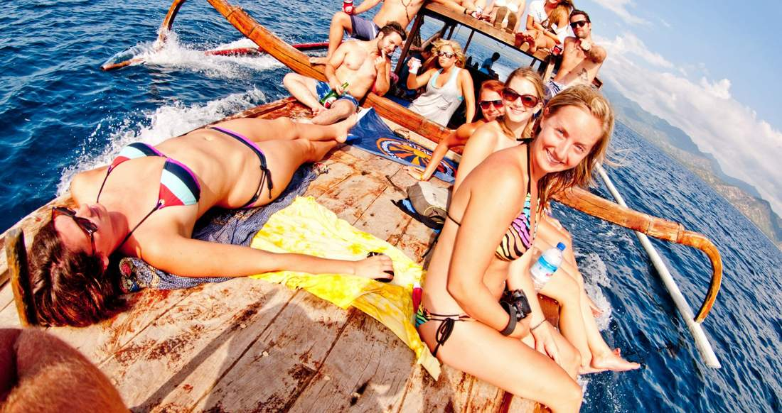 group shot of travelers on a boat in the Gili Islands, Indonesia