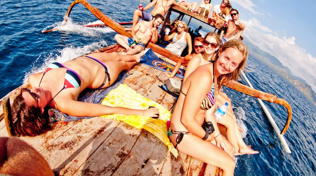 Group of girls on a boat enjoying the sun in Indonesia