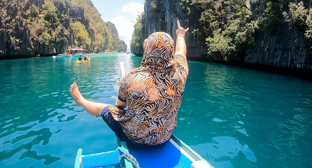 Traveler on a boat tour in the Philippines