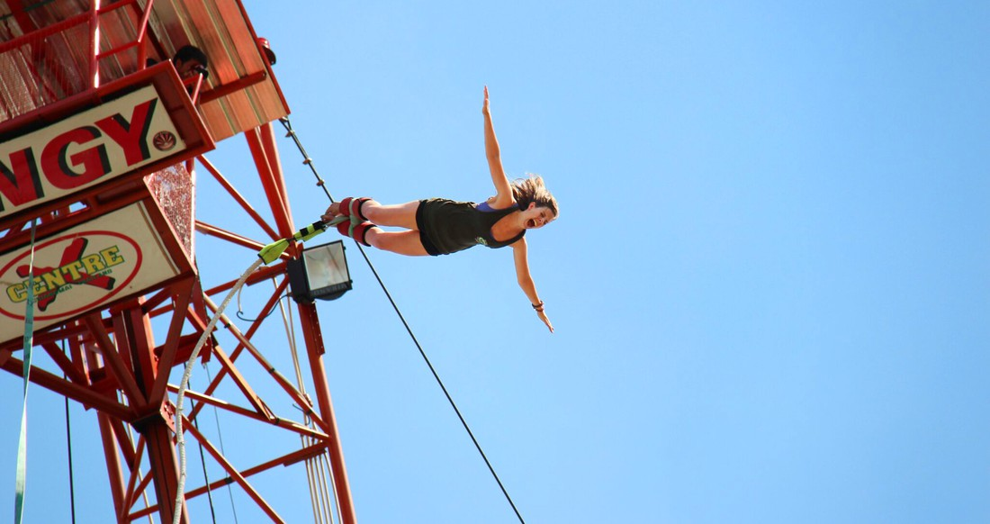 A traveler bungee jumping in Northern Thailand