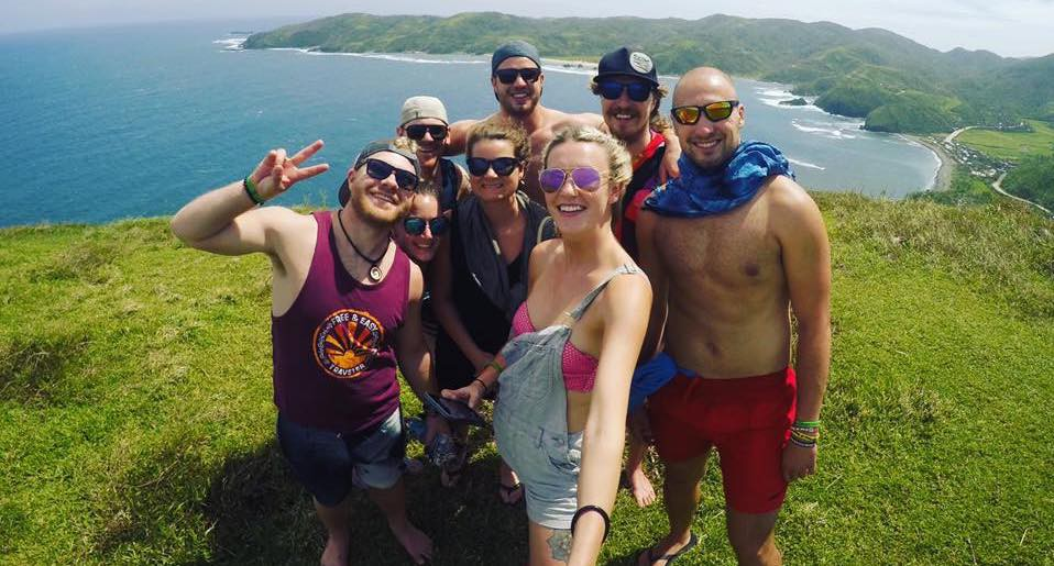 A group of travelers take a selfie in the Philippines