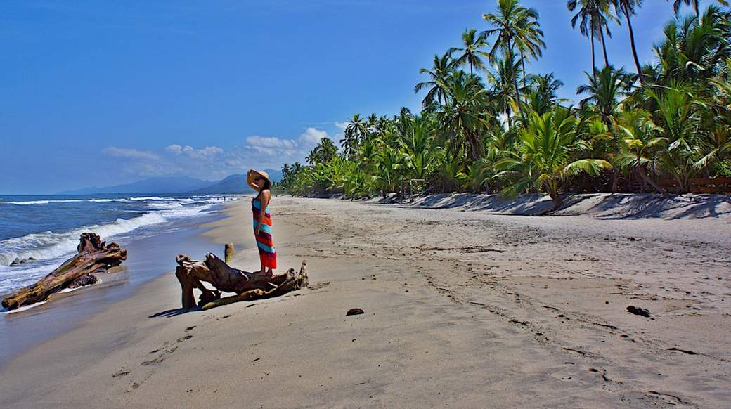 a girl admiring the ocean on costeno beach colombia