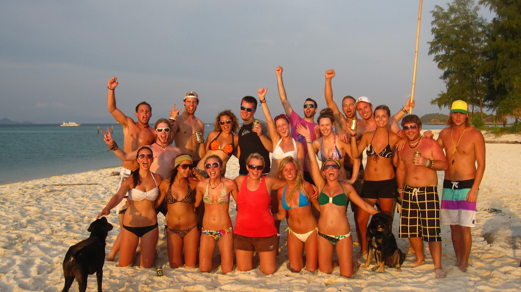 Group of happy travelers on a beach in Koh Lipe Thailand