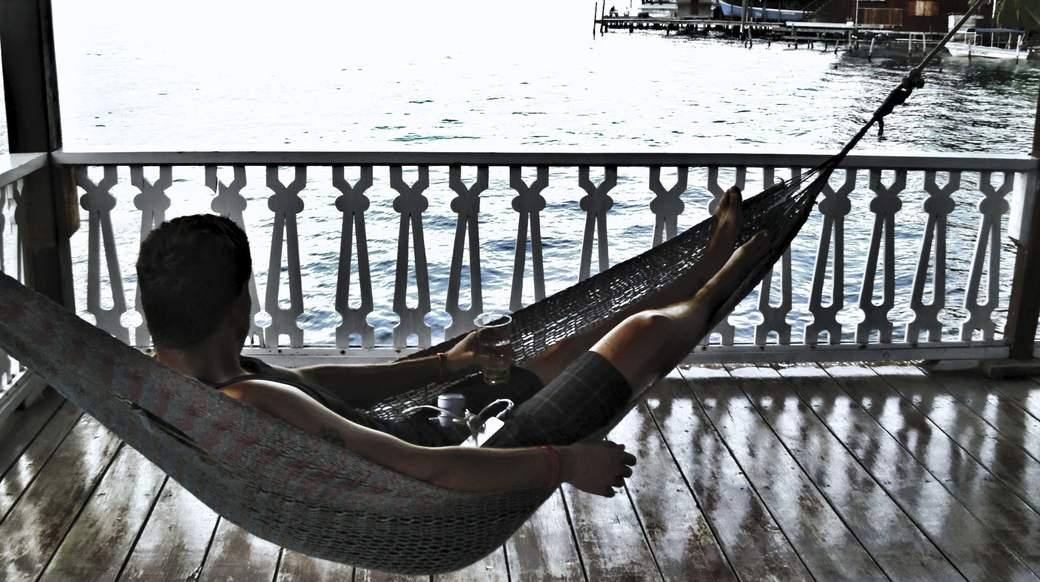 dude sitting in a hammock in bocas del toro panama