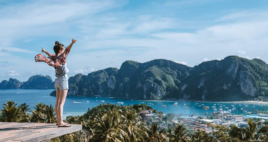 a girl standing in front of an epic Koh Phi Phi viewpoint in Thailand