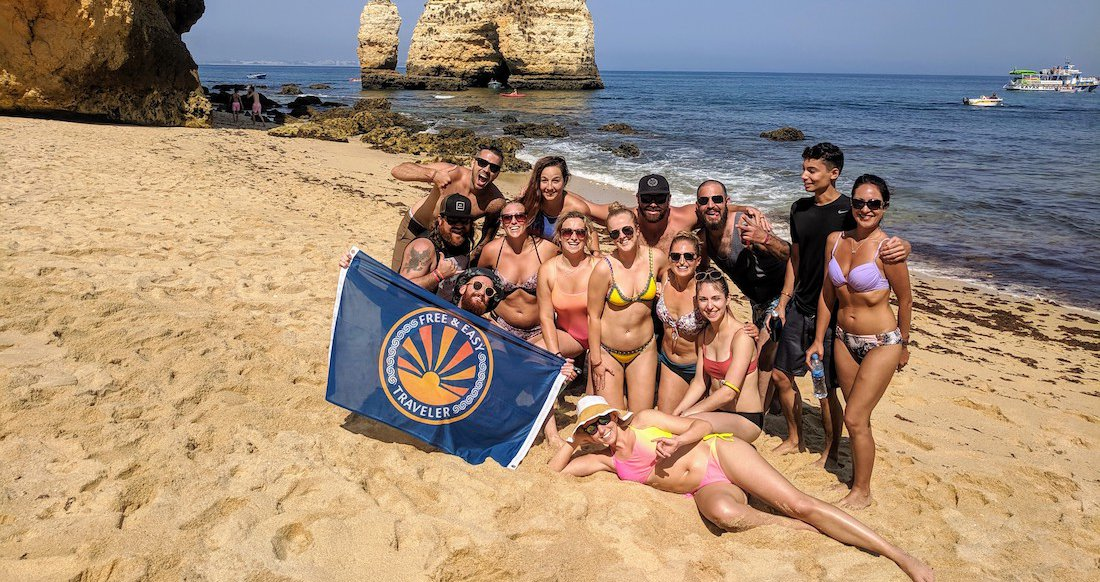 A group of young travelers posing on the beach
