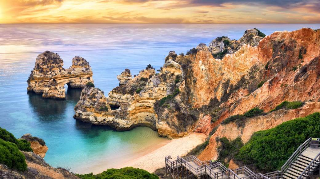 beautiful view of cliffs surrounding a beach in Lagos Portugal
