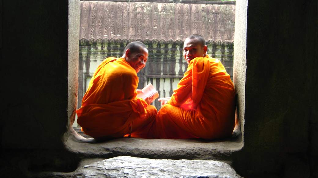 Two smiling monks in Angkor Wat Cambodia