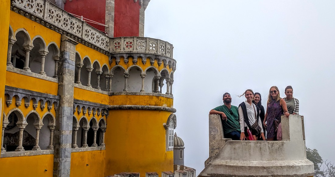 A group of travelers pose at pena palace