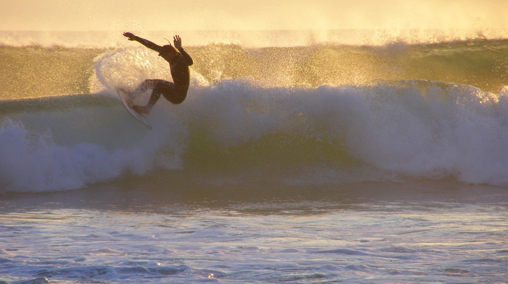 dude catching a wave in Sagres Portugal