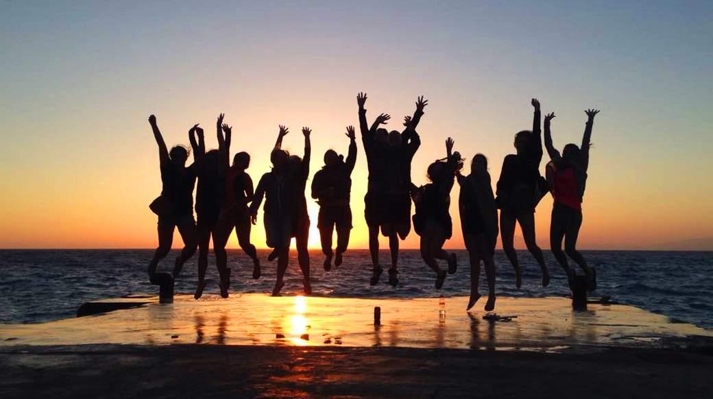 group enjoying a beautiful sunset in Rhodes Greece