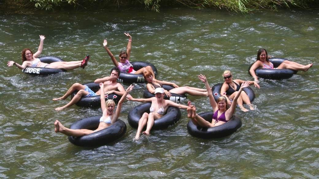 Group of girls floating down the river in Khao Sok Thailand