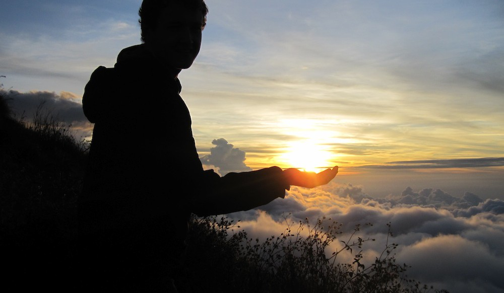 Epic sunset on top of a volcano in Indonesia