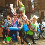 A group of people holding water guns celebrating thai new year.