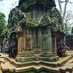 Group of travelers exploring Angkor Wat