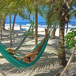 Girl napping in a hammock on Costeno Beach in Colombia