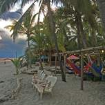 hammocks and chairs set up on Costeno beach in Colombia
