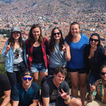 Group of travelers at the top of Cusco in Peru