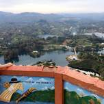 Girl looks out at a viewpoint in Guatape Colombia