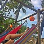 People chilling in hammocks on costeno beach in Colombia