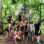 A group of travelers posing in the jungle.
