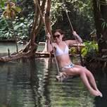 Girl sitting in a swing in Laos
