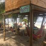 massage sign near hammocks on Costeno beach Colombia