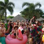 A group of travelers partying next to a pool