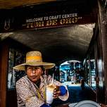 Local serving a pineapple shake in Peru