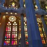 Massive modern stained glass windows inside the Sagrada Familia.