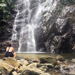Girl looking at a waterfall in Colombia