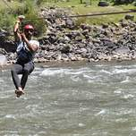 Zip lining over a river in Peru