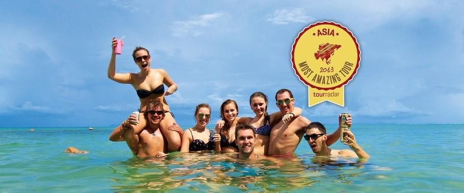 Group of travelers in the ocean in Thailand
